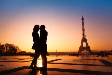 loving couple kissing on Eiffel Tower background, Paris, France