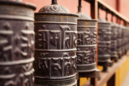 sanskrit: prayer mills in buddhist monastery
