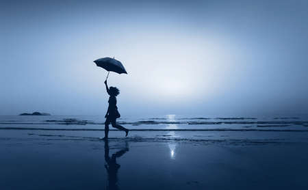 woman with umbrella: follow your dream