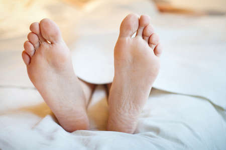 convalescence: feet of patient in the hospital Stock Photo