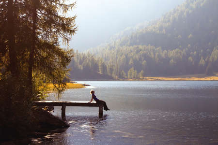 healthy life: young woman enjoy the nature on the mountain lake
