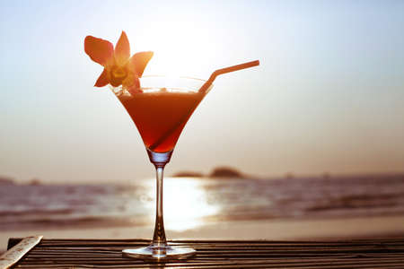 tropical sunset: cocktail on the beach Stock Photo