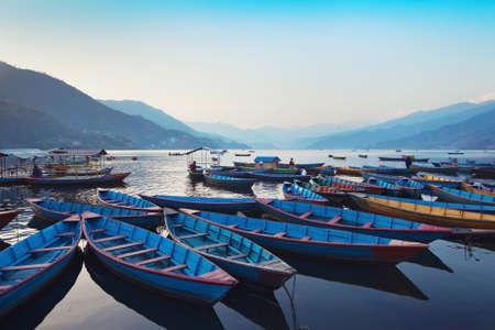 phewa: beautiful view of wooden boats in Phewa lake, Pokhara, Nepal Stock Photo