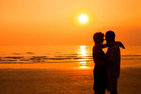 sexual relations: happy retired couple on the beach Stock Photo