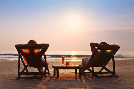 happy couple enjoy sunset on the beach Banco de Imagens