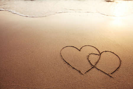 evoking: two hearts on the beach