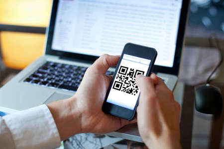 quick response code: smart phone with qr code on the screen Stock Photo