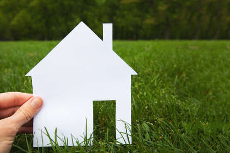 hand paper: real estate concept, hand holding house