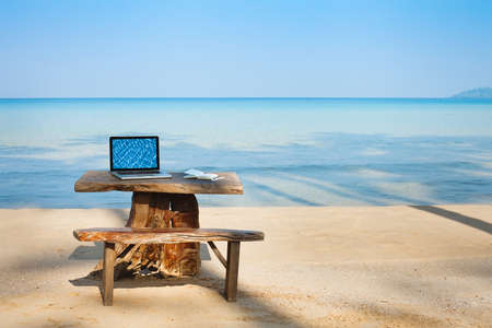 distant: office on the beach, computer and table