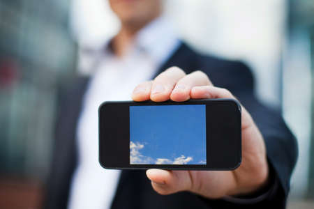 phone business: smartphone in the hand of businessman
