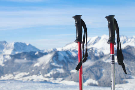 ski walking: skiing in mountains, close up of two ski poles