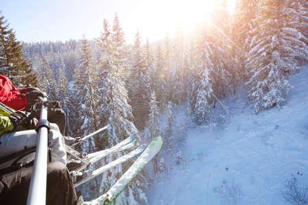 kids at the ski lift: family sitting in ski lift