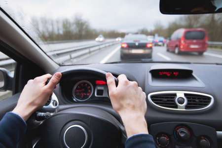 driving car on highway, close up of hands on steering wheel Stok Fotoğraf
