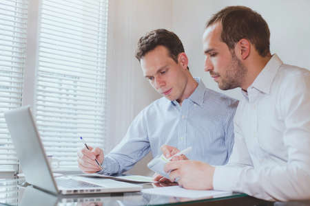 business people working on project in modern office interior Stock Photo