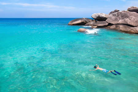 snorkeling in turquoise water