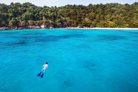 paradise beach: snorkeling background, swimming with mask and snorkel on paradise beach