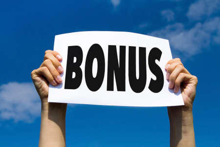 bonus concept, hands holding paper sign