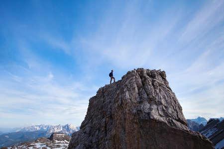 achievment: achievment concept, climber on top of the mountain