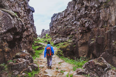 hiking in rocky canyon, backpacker walking in the nature, Iceland