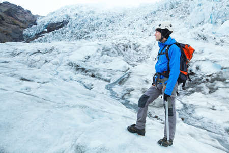 alpinist climber in crampons and all gear on the glacier Фото со стока