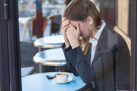 woman crying in cafe