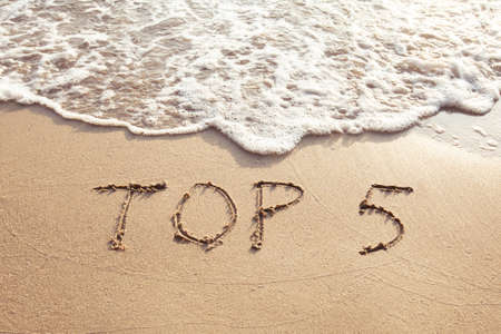 Top 5, sign concept, list of five best, text on the sand beach