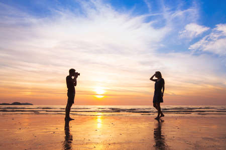photo pictures: photographer and model, beach photo shooting at sunset, man taking pictures of woman