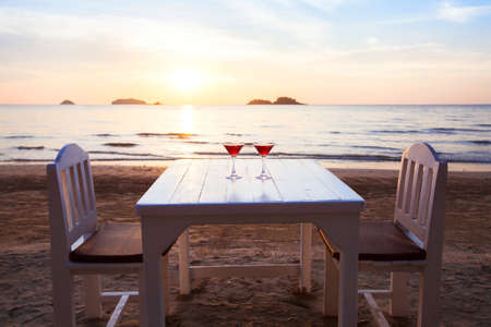 table in restaurant on the beach with two cocktails