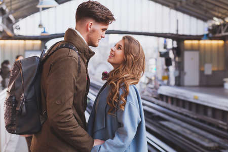 long distance relationship, couple on platform at the train station, meeting or parting concept