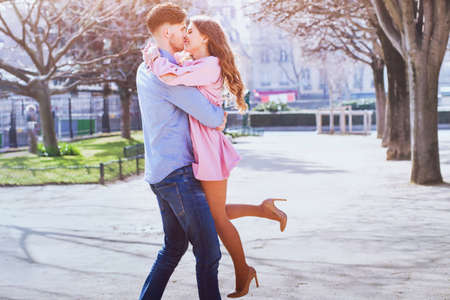 happy young beautiful couple kissing and smiling outdoors