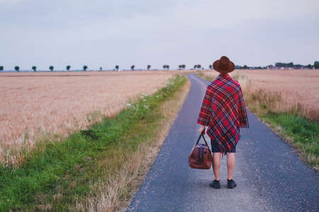 leaving home, traveler walking on the road, summer trip, journey or travel background