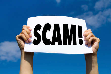 scam concept sign, hands holding white paper with message text alert Archivio Fotografico