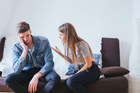 relationship problems in young family, angry woman wife and tired indifferent man husband