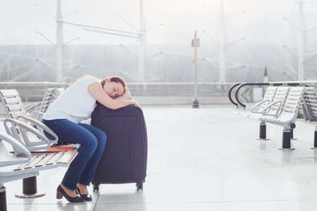 woman sleeping in the airport, transit passenger