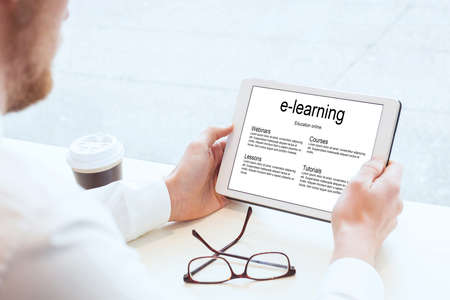e-learning, business education online, hands with tablet Stock Photo