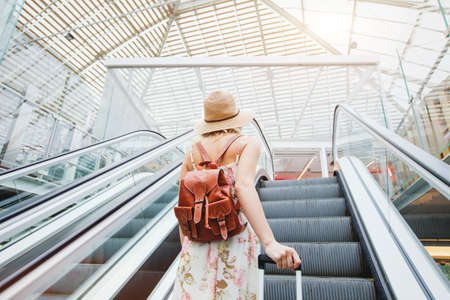woman in modern airport, people traveling with luggage Stockfoto