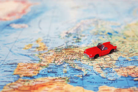 rent car concept, rental vehicle, toy on the map Stock Photo