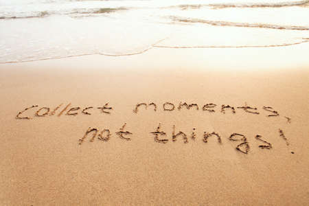 collect moments, not things - happiness concept, happy lifestyle inspirational quote, enjoy the life, text on sand Stock Photo - 77408980
