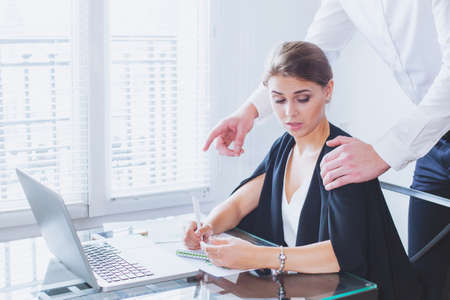 inappropriate: Sexual harassment at work, office woman and her lustful boss Stock Photo