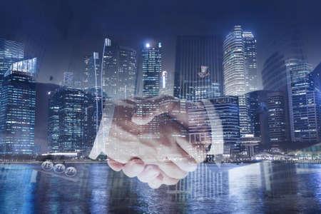 契約または契約のビジネス コンセプト、ハンドシェイク二重露光、協力やパートナーシップ 写真素材