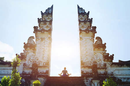 Yoga in Bali, meditation in the temple, spirituality and enlightenment Фото со стока