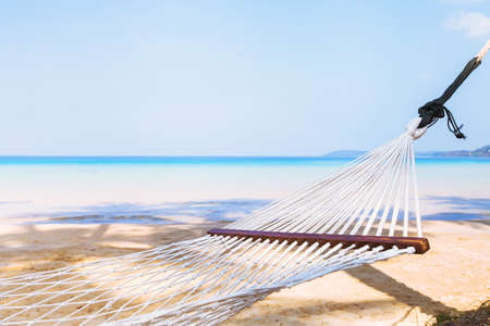 beach holidays, tourism concept background, empty hammock in hotel on paradise island