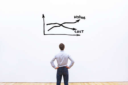 decrease cost and increase value business concept, businessman analyzing graph Stock Photo