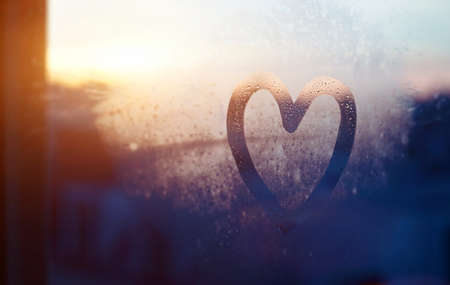 valentines day card, love and kindness concept, heart painted on frozen glass window Stok Fotoğraf