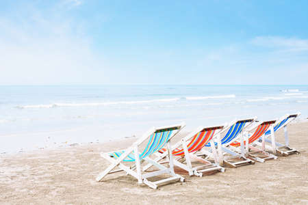 empty deck chairs on the beach, crisis in tourism or family holidays background