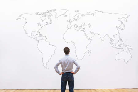 businessman looking at the world map, international career opportunity concept, business background