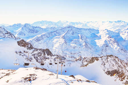ski station in the mountains, lift and panoramic winter landscape