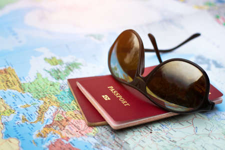 travel concept, two passports on the map of the world, holidays abroad Stock Photo