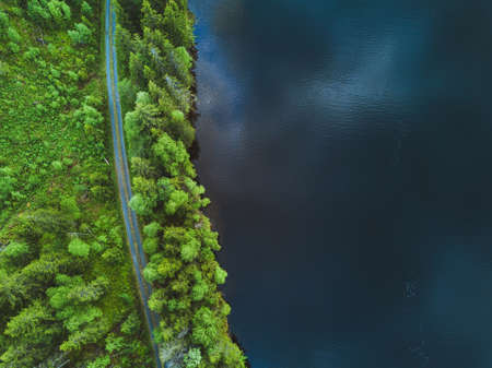 aerial nature background, top view of road and  beautiful texture of water and forest