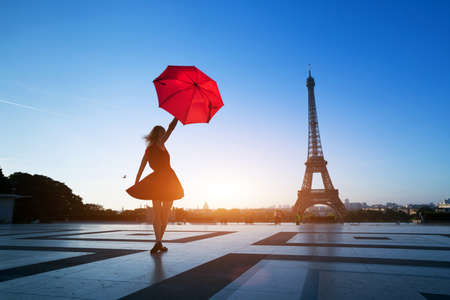 travel to Paris, silhouette of beautiful girl with red umbrella near Eiffel Tower Reklamní fotografie